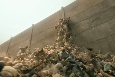 Zombies climbing over each other to reach the top of the wall surrounding Jerusalem